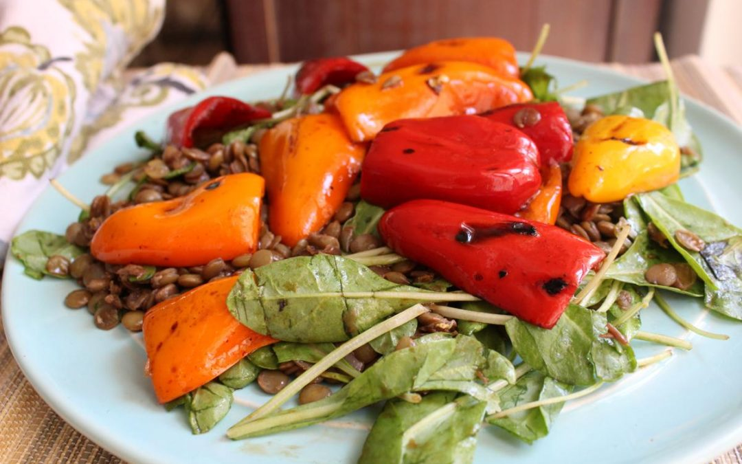 Lentil salad with grilled peppers and fresh spinach
