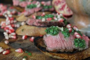 Steak with mint pomegranate sauce