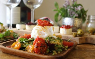 Salad with poached eggs and a cheese plate